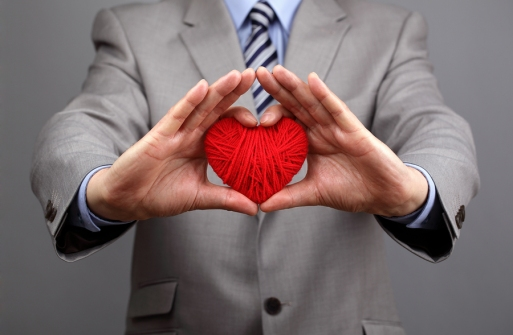 Man holding a red woolen heart concept for valentine's day, busi